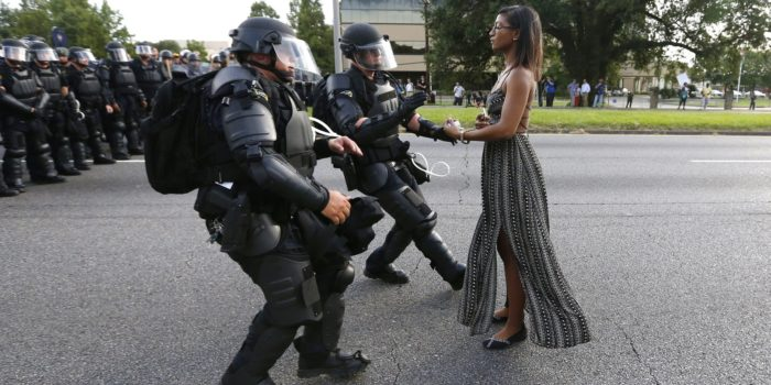 A demonstrator protesting the shooting death of Alton Sterling is detained by law enforcement near the headquarters of the Baton Rouge Police Department in Baton Rouge, Louisiana, on July 9, 2016.